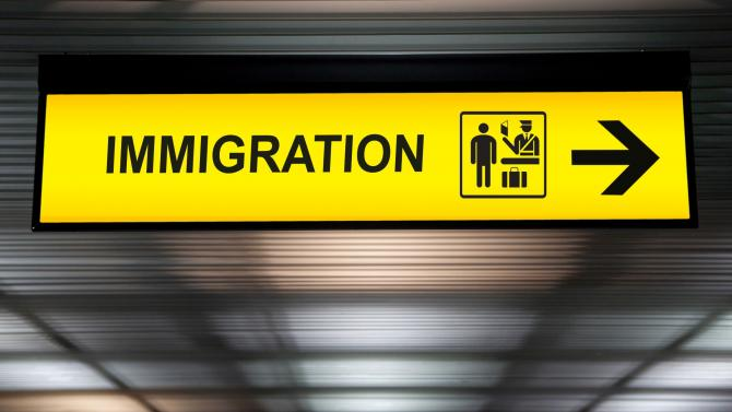 Immigration sign with arrow at an airport