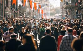 Throngs of people walk on a crowded street in Istanbul
